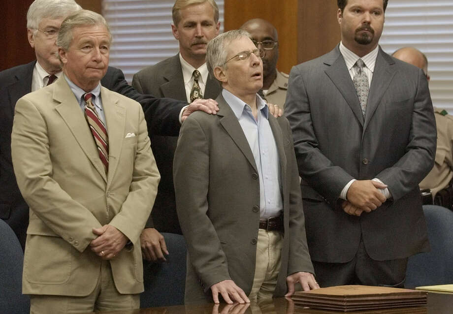 Surrounded by his attorneys, multi-millionaire murder defendant Robert Durst,center, reacts to a not guilty verdict Tuesday, Nov. 11, 2003, in Galveston. Photo: PAT SULLIVAN, AP / AP