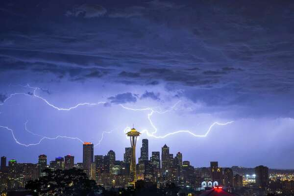 August 10, 2013 ?' Lightning streaks over the Seattle skyline in this view from Queen Anne. Summer thunderstorms over Western Washington put on rare and spectacular light shows.
