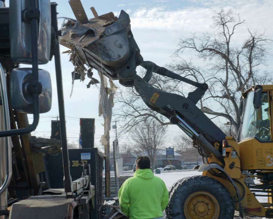 North Benson Road was closed Thursday morning while crews cleaned up the debris from an oversized load that hit the railroad overpass around 4 a.m. Photo: Genevieve Reilly / Fairfield Citizen