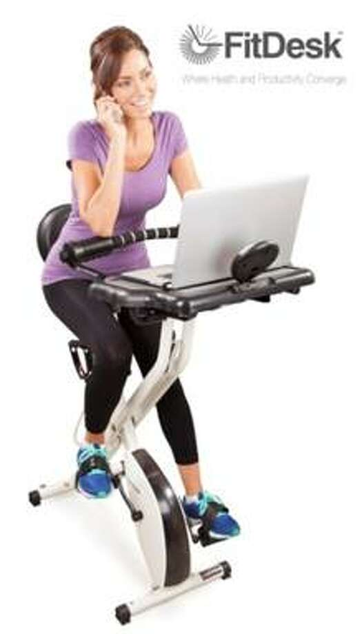 "Fitdesk 2.0 boasts: ""Work out while comfortably typing on a laptop or playing the latest video game."" Jack La Lanne is probably  spinning in his grave. Photo: Courtesy Of Fitdesk.com"