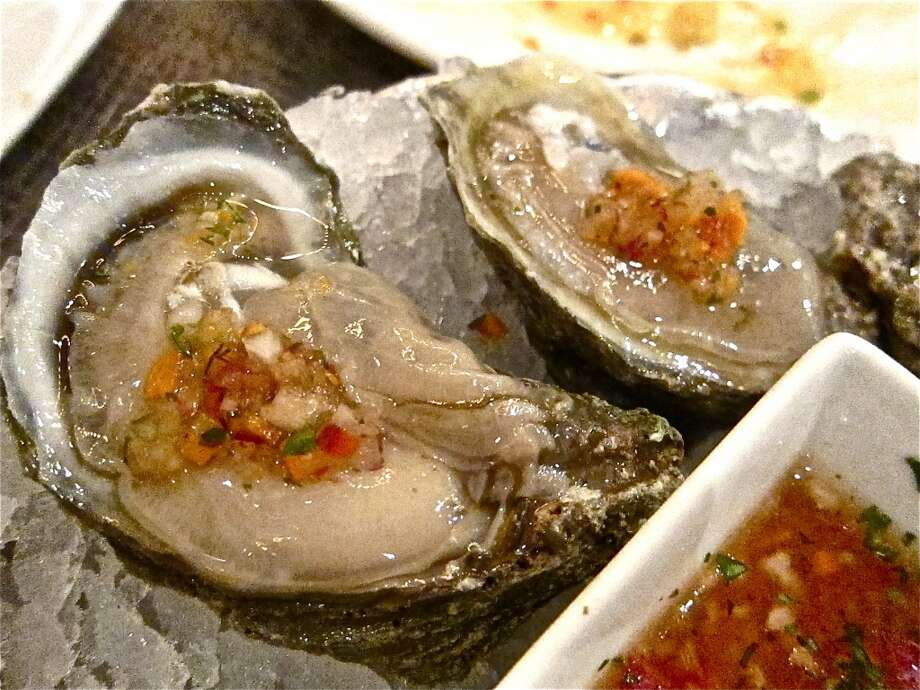 Gulf oysters on the half shell with salsa bruja at Caracol. Photo: Alison Cook