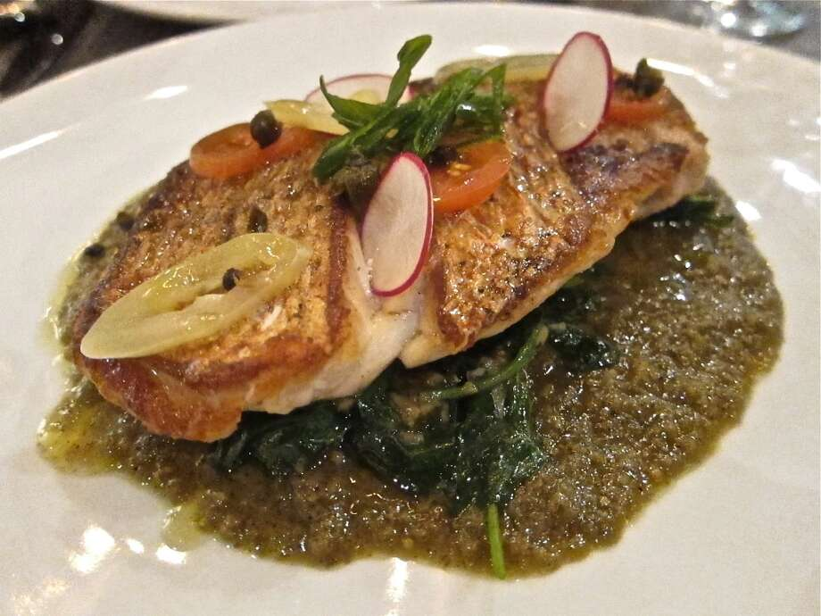 Snapper a la plancha with tomatillo-caper sauce, greens and crispy shallot at Caracol. Photo: Alison Cook