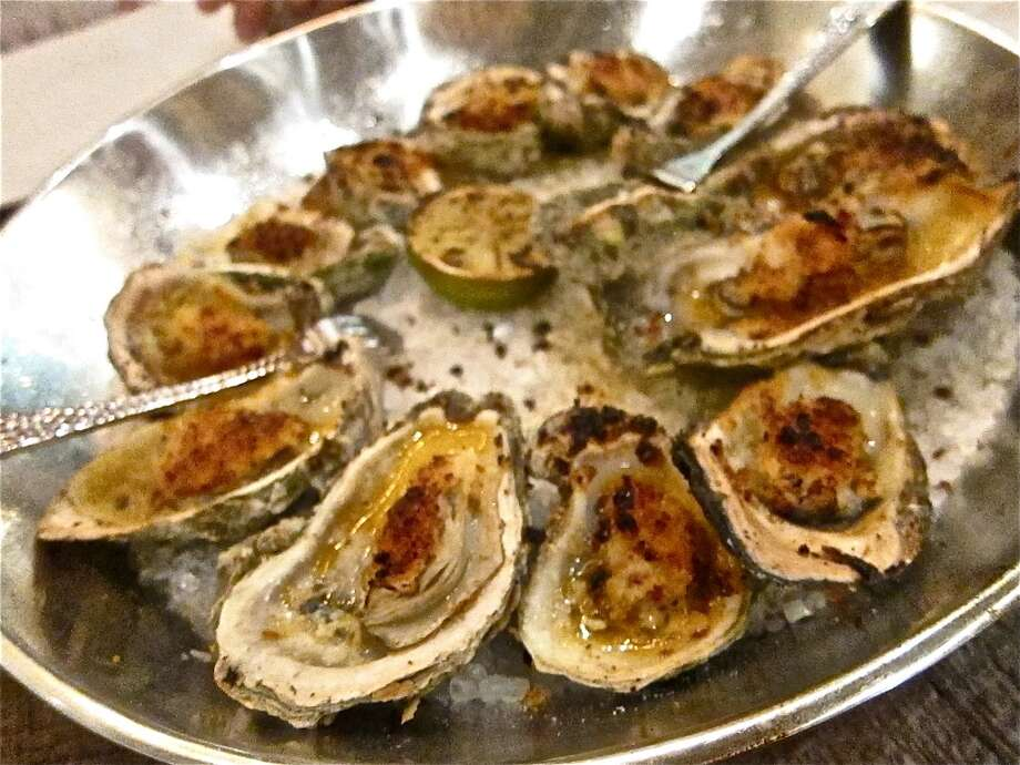 Wood-roasted Gulf oysters with chipotle butter. Photo: Alison Cook