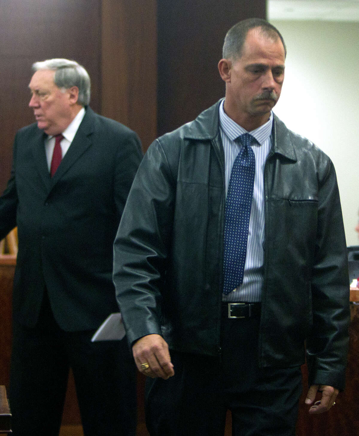 Former Deputy Donald Wayne Tipps leaves court after appearing Thursday, Dec. 19, 2013, in Houston. The former Harris County Sheriff's Deputy was indicted for sexual assault and official oppression, accused of coercing a woman into sex instead of arresting her for an open warrant.