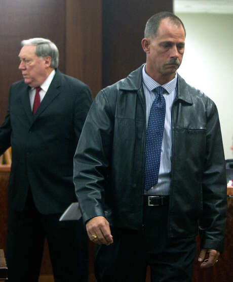 Former Deputy Donald Wayne Tipps leaves court after appearing Thursday, Dec. 19, 2013, in Houston. The former Harris County Sheriff's Deputy was indicted for sexual assault and official oppression, accused of coercing a woman into sex instead of arresting her for an open warrant. Photo: Cody Duty, Houston Chronicle / © 2013 Houston Chronicle