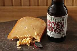 Lagunitas Brown Shugga beer with L'Amuse Gouda as seen in San Francisco, California on Wednesday, December 18, 2013. Food styled by Lauren Reuthinger.