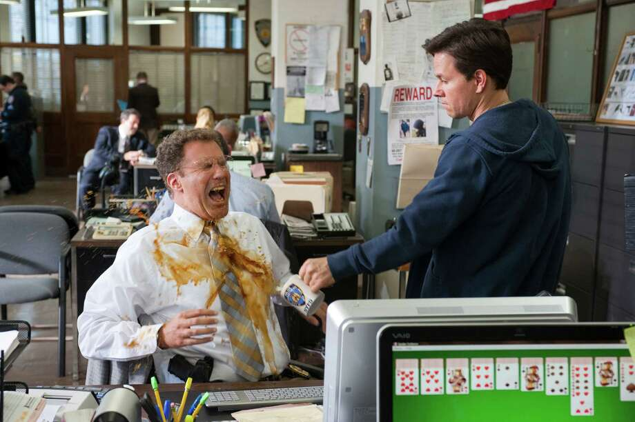 "Will Ferrell, left, and Mark Wahlberg star in the buddy-cop parody ""The Other Guys."" Photo: Macall Polay, THE OTHER GUYS / Website download"