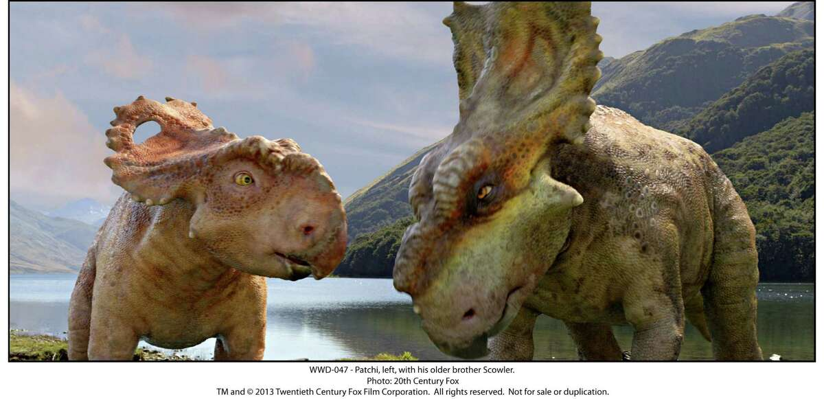 """Patchi, left, migrates with his family, including older brother Scowler, in """"Walking With Dinosaurs."""""""