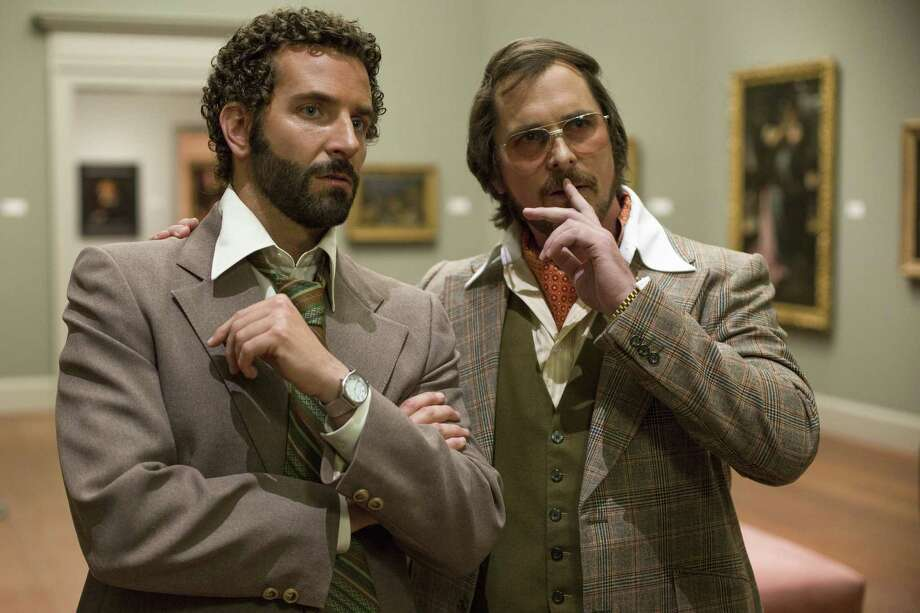 """Bradley Cooper, left, and Christian Bale star as an FBI agent and a con man in """"American Hustle."""" Photo: HANDOUT, HO / MCT"""