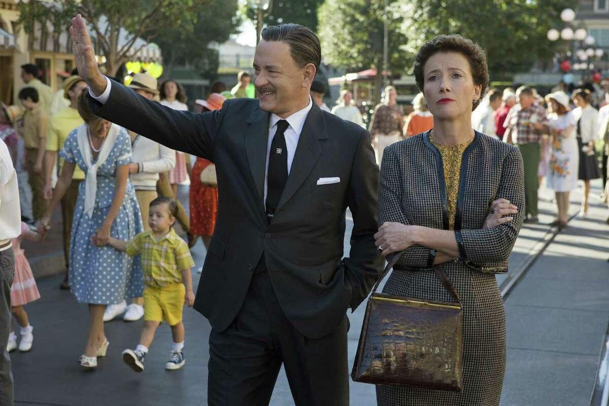 "Walt Disney (Tom Hanks) shows Disneyland to ""Mary Poppins"" author P.L. Travers (Emma Thompson) in ""Saving Mr. Banks."""