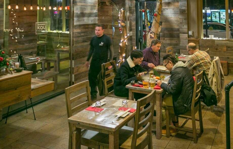 Diners enjoy dinner at Izakaya Hashibiro Kou in San Francsico. Photo: John Storey, Special To The Chronicle