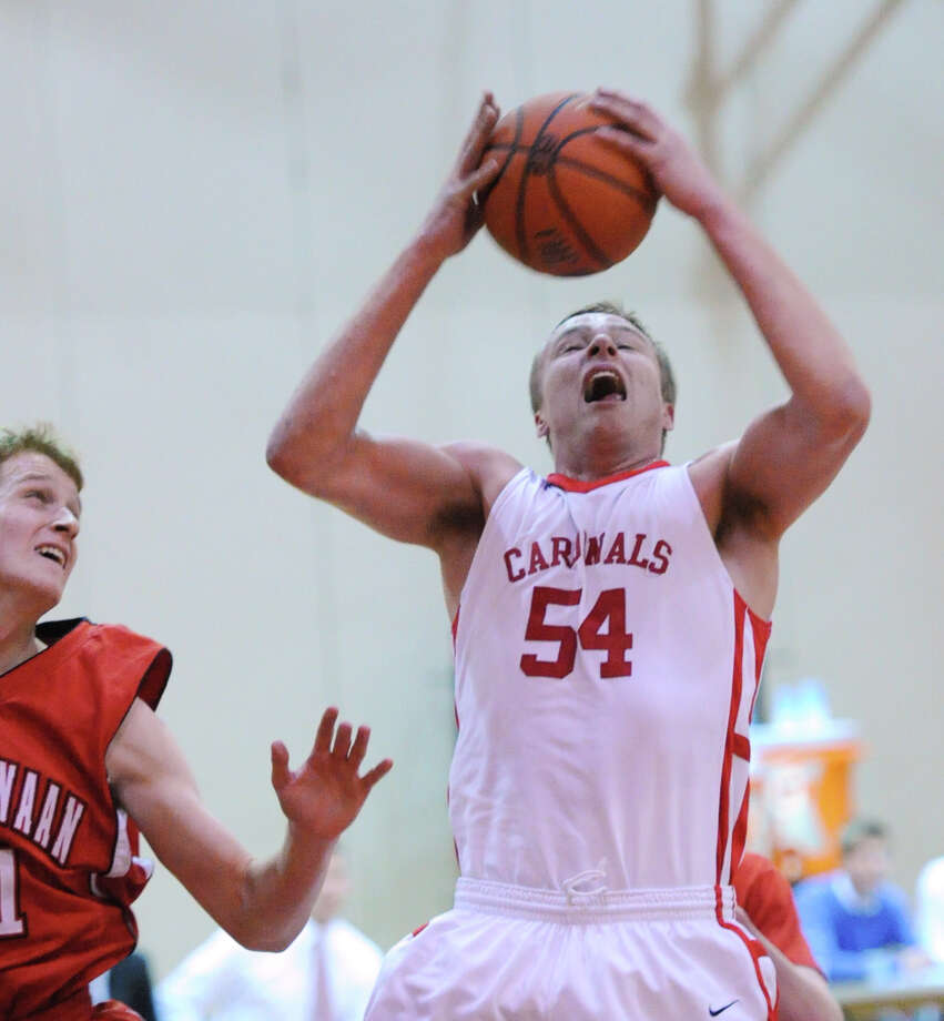 Alex Wolf (# 54) of Greenwich grabs a rebound during the boys varsity basketball game between Greenwich High School and New Canaan High School at Greenwich, Wednesday night, Dec. 18, 2013. Photo: Bob Luckey / Greenwich Time
