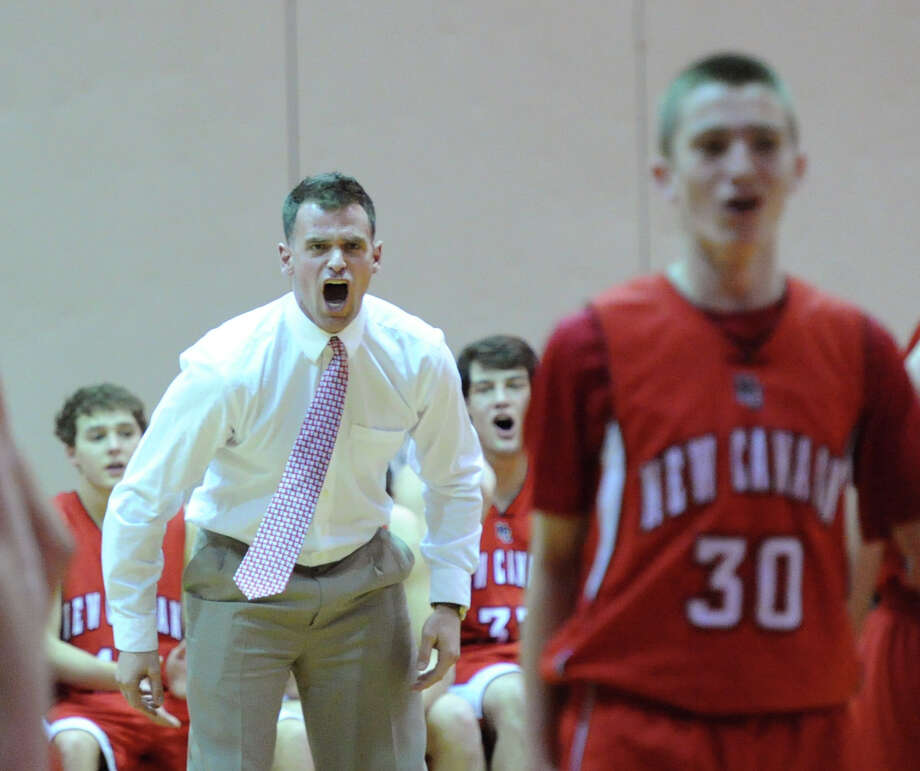 At left, New Canaan High School  boys basketball head coach Mike Evans screams during the boys varsity basketball game between Greenwich High School and New Canaan High School at Greenwich, Wednesday night, Dec. 18, 2013. Photo: Bob Luckey / Greenwich Time