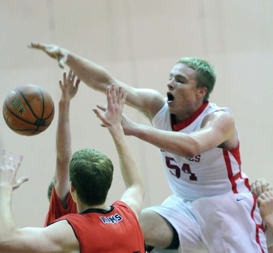 Alex Wolf of Greenwich, right, in action during the boys varsity basketball game between Greenwich High School and New Canaan High School at Greenwich, Wednesday night, Dec. 18, 2013. Photo: Bob Luckey / Greenwich Time