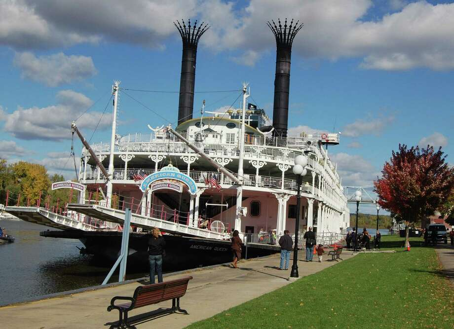 The American Queen is tied up in Red Wing, Minn., (top) within walking distance of a clean, neat downtown festooned with seasonal decorations.
