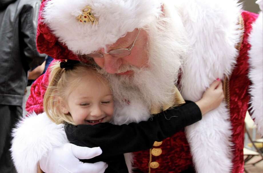 Santa Claus is a big part of the magic of Christmas. Sometimes keeping the magic alive takes a lot of work at home. Photo: Jason Fochtman / Associated Press / Conroe Courier