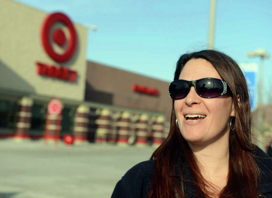 Anna Hackett, of Stratford, reacts to news of Target's credit and debit card security breach as she leaves the store in Trumbull, Conn. Thursday, Dec. 19, 2013. Photo: Autumn Driscoll / Connecticut Post