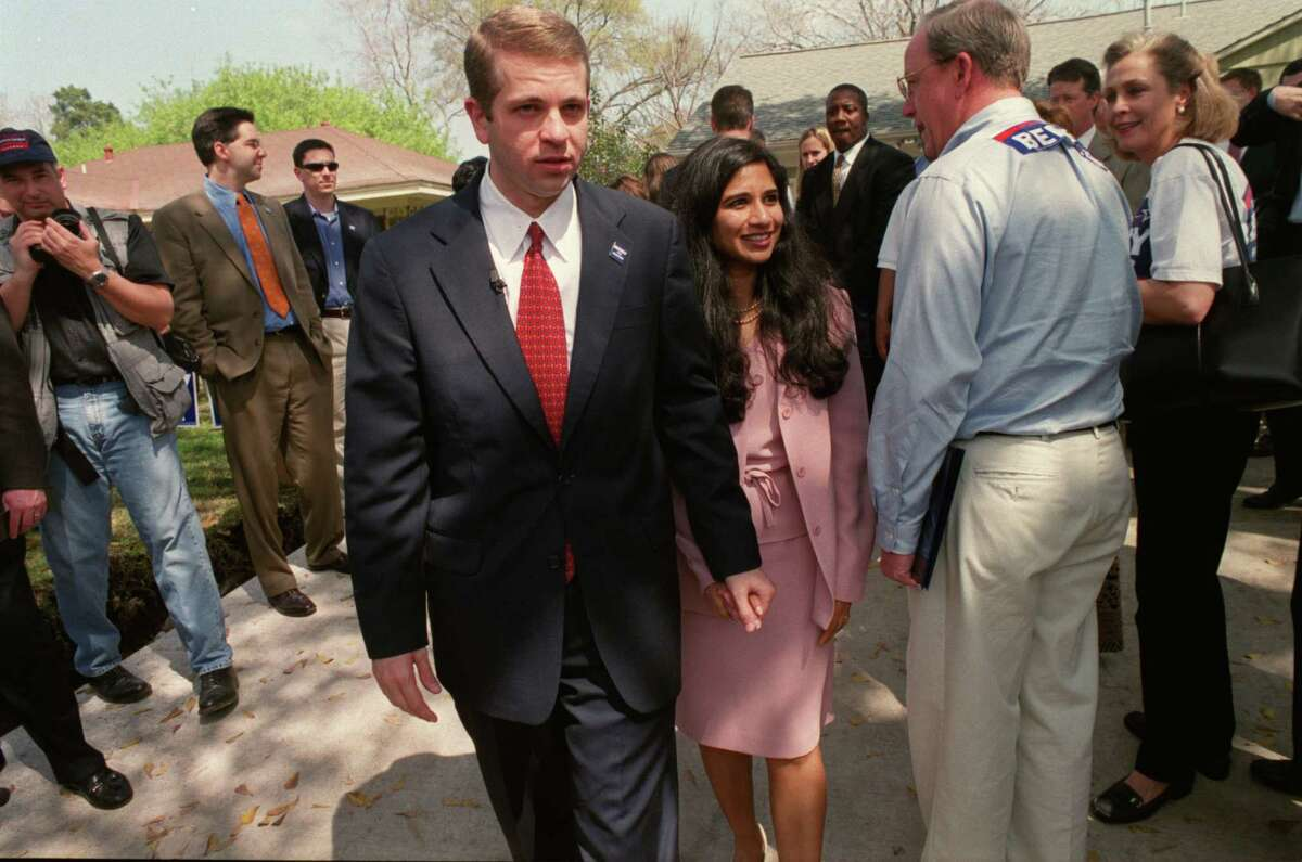 In this 2003 file photo, Nandita Berry walks next to her husband, Michael Berry, when he announced his intentions to run for Houston mayor.