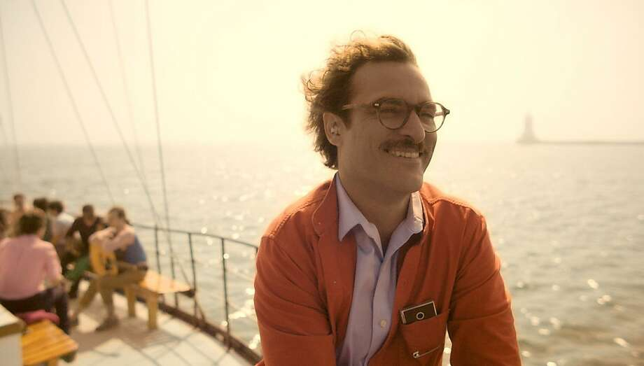 "In Spike Jonze's ""Her,"" Joaquin Phoenix is love with Scarlet Johansson - who is a computer. Photo: Handout, McClatchy-Tribune News Service"