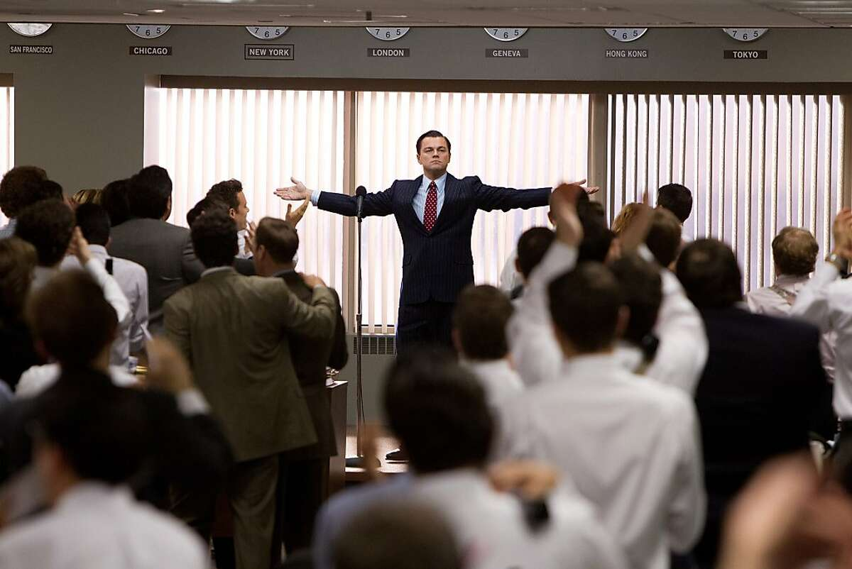Leonardo DiCaprio (center, standing) plays Jordan Belfort in THE WOLF OF WALL STREET, from Paramount Pictures and Red Granite Pictures.