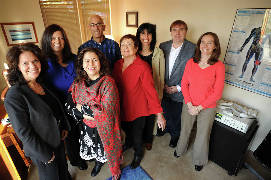 Center for Energy's community of holistic practitioners from left; Feng Shui specialist Tracy Boyce, massage and energy work specialist Marcy Furano, Soul doctor Ma Prem Jothi Samadhi, energy and meditation specialist John Mercede, transformational coach Rona Weinstein, reflexology/nutrition specialist Cheryl Bonomo, doctor of oriental medicine and Harmonetiks specialist Jeffrey Zimmerman, and Ondamed specialist and addiction recovery coach Mary Von Ohlen. Photo: Brian A. Pounds / Connecticut Post