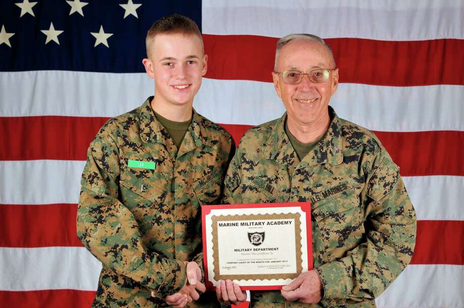 Richard Lee, left, received the Cadet of the Month honor from Col. R. Glenn Hill, superintendent of the Marine Military Academy. Photo: Courtesy Of The Marine Military Academy