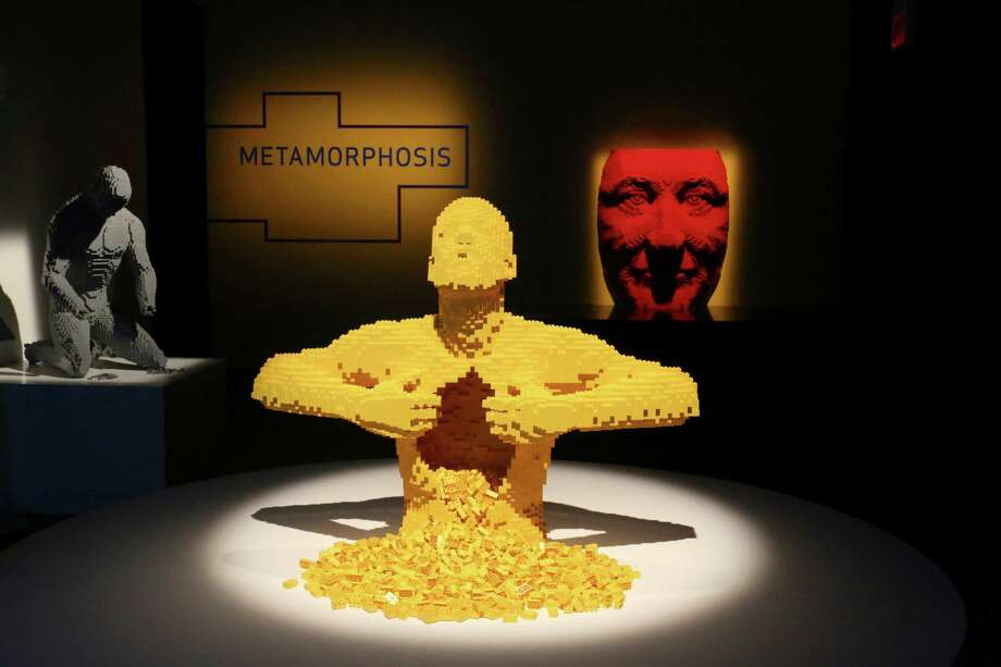 """Nathan Sawaya's Yellow Lego block sculpture at """"The Art of the Brick"""" exhibition at Discovery Times Square in New York, June 10, 2013. Sawaya's sculptures made of basic Lego blocks mimic the world and other artists' view of it. (Suzanne DeChillo/The New York Times) Photo: SUZANNE DECHILLO / NYTNS"""