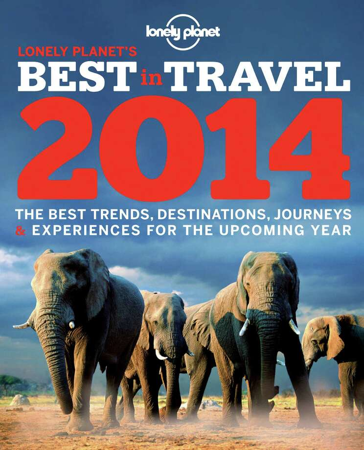 "This image provided by Lonely Planet shows the cover of the travel guidebook company's book ""Best in Travel 2014,"" an annual guide to trends, destinations, journeys and experiences for the new year. (AP Photo/Lonely Planet) ORG XMIT: MER2013121015412267 / Lonely Planet"
