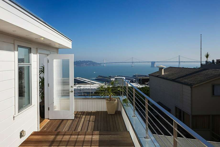 The wood deck off the master bedroom looks at the classical span of the Bay Bridge. Photo: Jacob Elliott Photography