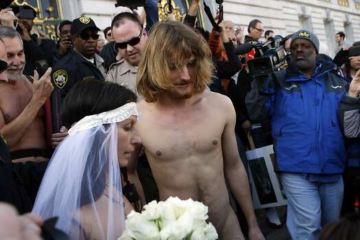 In San Francisco, you don't get rid of your politics with your clothes. Jaymz Smith and Gypsy Taub here are perparing to be married on the steps of the city's City Hall last month. They are naked, save for the veil. Oh, that's nudity activist Gypsy Taub, sorry for the omission. Photo: Michael Short, The Chronicle