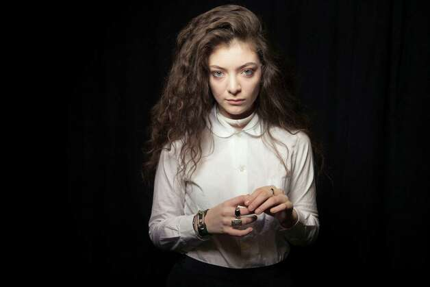 This Nov. 8, 2013 photo shows New Zealand singer Lorde in New York. MTV's college channel has gone in two wildly different directions in naming Pope Francis and pop singer Lorde as its man and woman of the year. MTVU said Tuesday, Dec. 10, that both figures challenged their followers with unexpected stands. (Photo by Victoria Will/Invision/AP) ORG XMIT: CAET419 Photo: Victoria Will / Invision