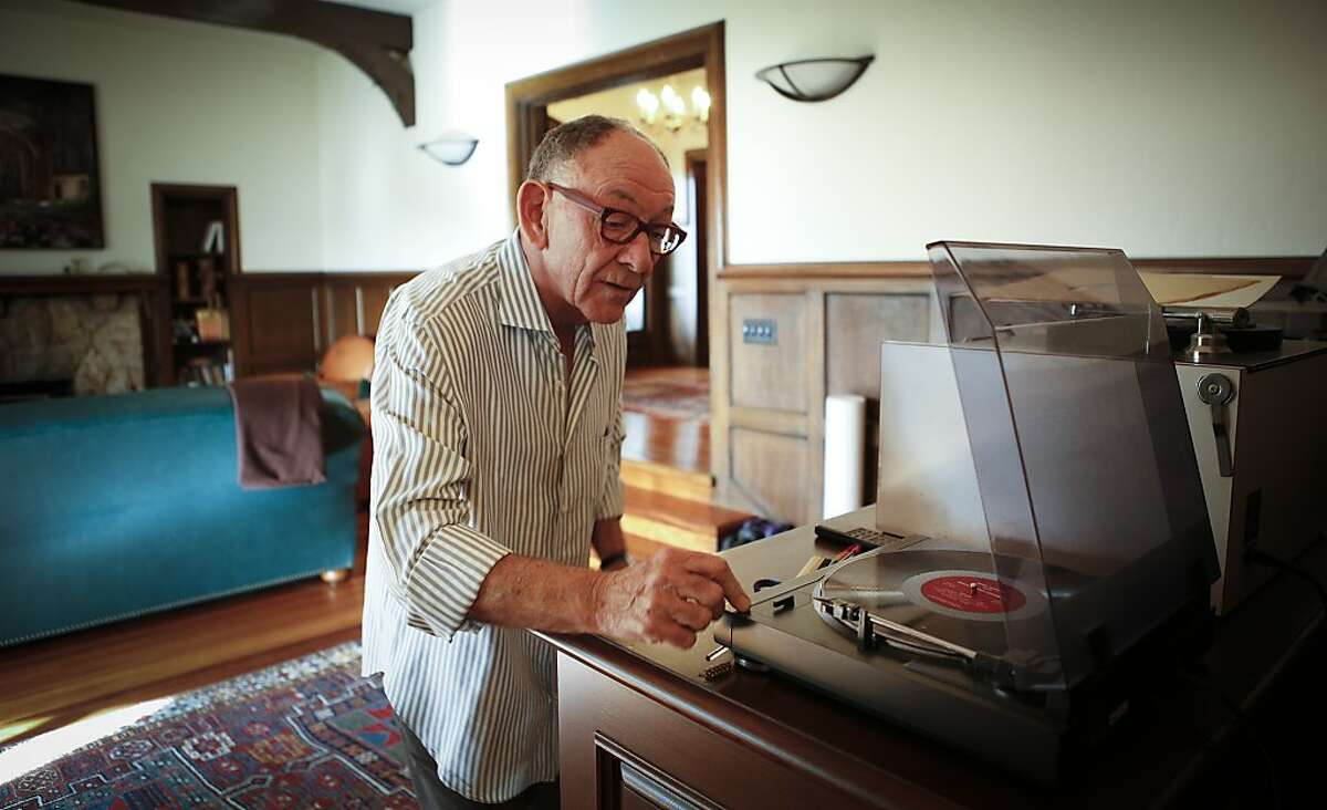 Wine importer Kermit Lynch, seen in his Berkeley, Calif., home on Tuesday, Dec. 17, 2013, prepares to play one of his vinyl lp's. Lynch is an avid singer who records cd's.