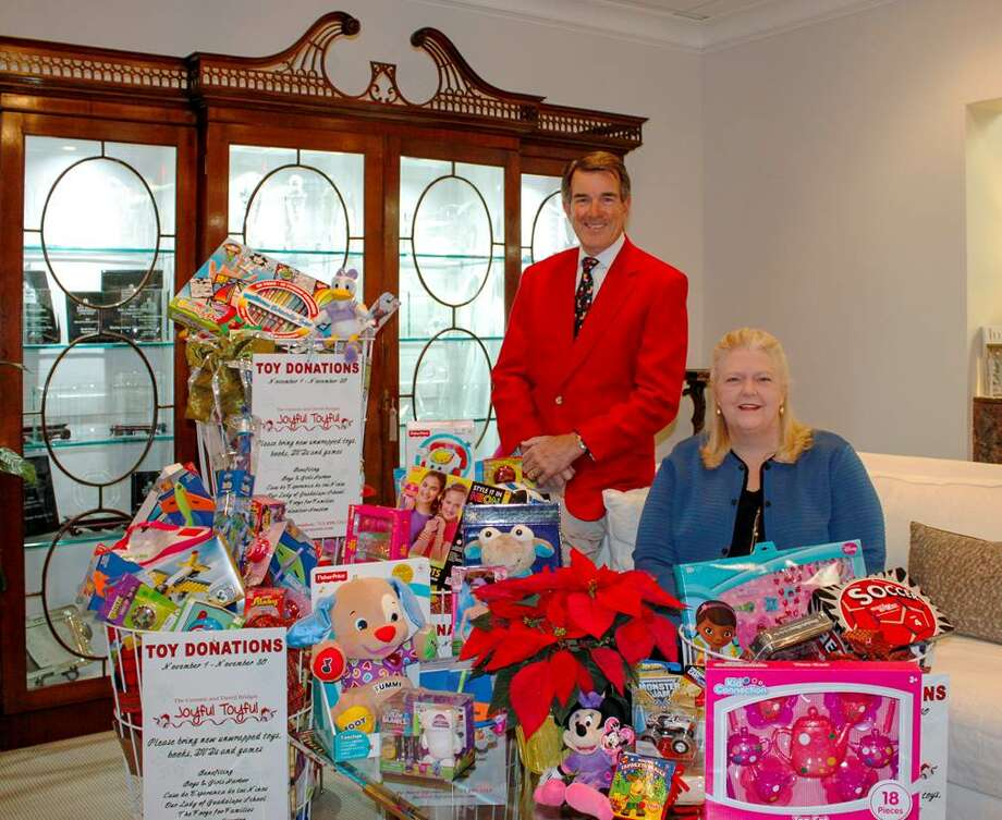 Tom Anderson, vice president and partner, and Marilyn Thompson, vice prosident of sales, with Martha Turner Properties' Joyful Toyful collection.