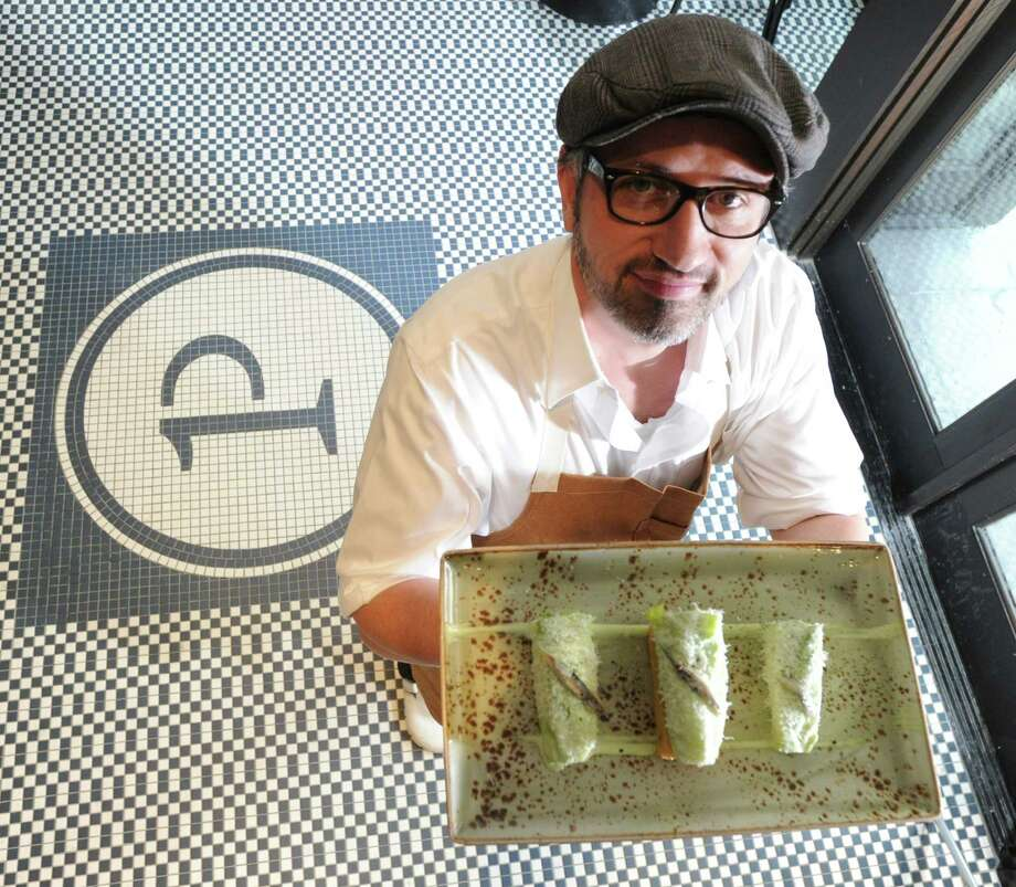 Chef Merlin Verrier with his Deconstructed Caesar Salad consisting of romaine hearts, spanish anchovy, parmesan fluff and brioche twinkie at Primary Food & Drink at 409 Greenwich Ave., Greenwich, Conn., Thursday, Dec. 19, 2013. The restaurant is the first on the east coact opened by Chef & Restaurateur Graham Elliot who is collaborating with Verrier, executive chef and managing partner, with a menu of contemporary American seasonal cuisine. Photo: Bob Luckey / Greenwich Time