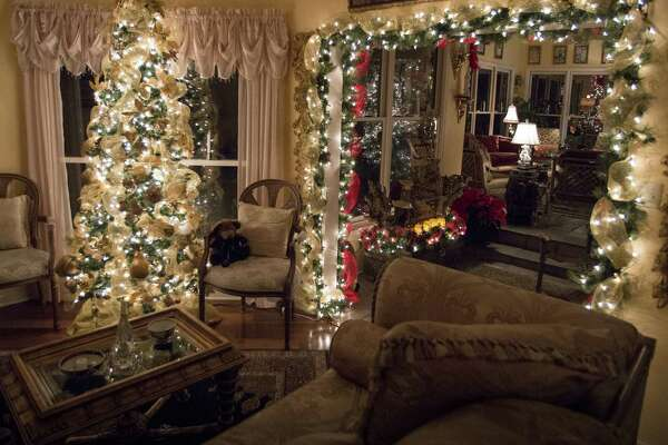 Jack Mondin decorates throughout his Elm Creek house. He begins putting up his 11 trees in October to be ready for Thanksgiving entertaining.