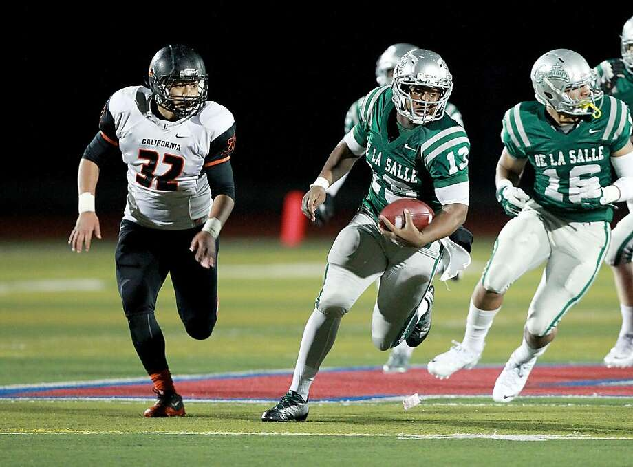 QB Chris Williams, a brother of two former De La Salle standouts, leads the Spartans into the state title game Saturday. Photo: Dennis Lee, MaxPreps