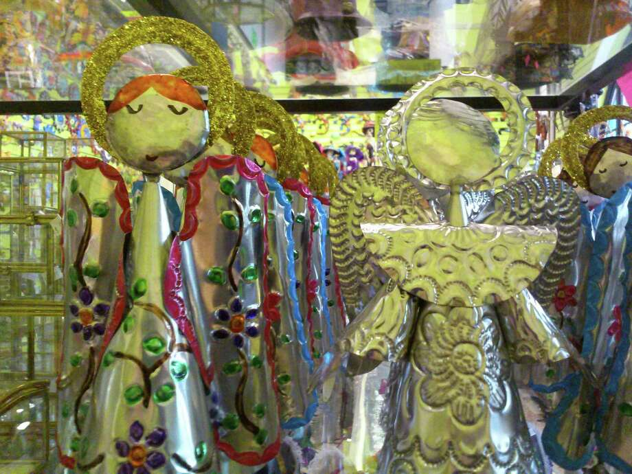 Tin angels of varying sizes and varying prices can be found at  Galleria. Photo: Tricia Schwennesen