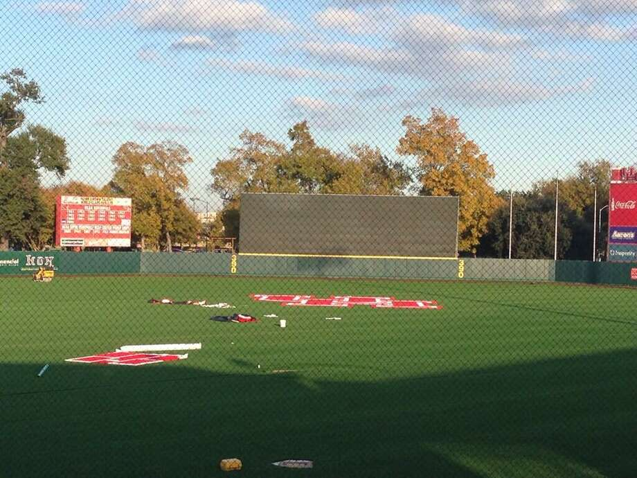 A UH logo is applied to the new turf at Cougar Field. Photo: Joseph Duarte