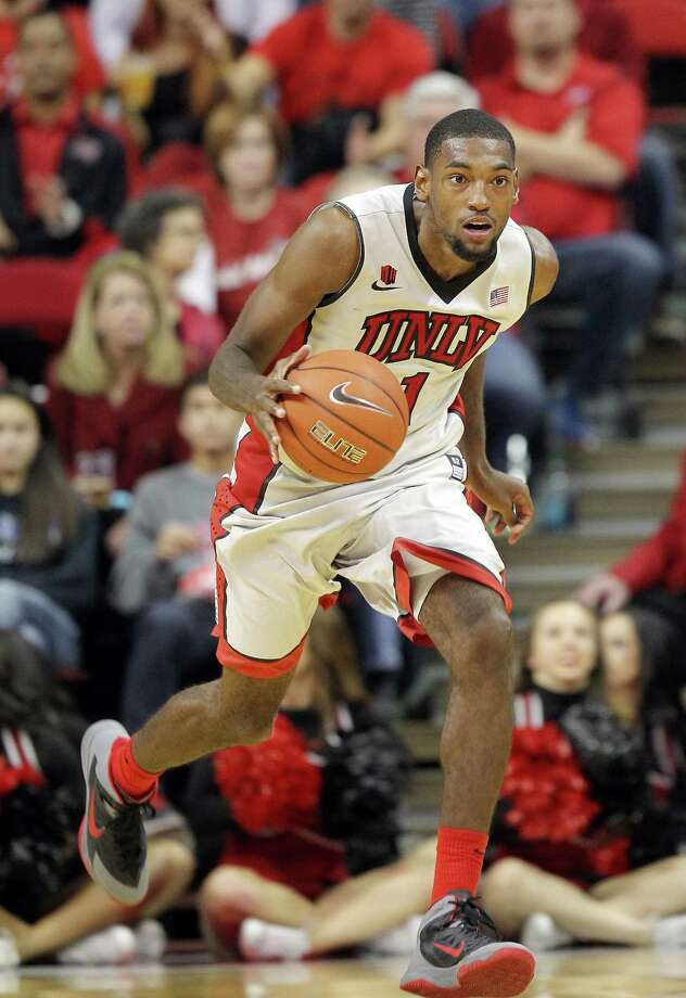 UNLV's Roscoe Smith drives the ball during an NCAA college basketball game against Arizona State on Tuesday, Nov. 19, 2013, in Las Vegas. Arizona State defeated UNLV 86-80. (AP Photo/Isaac Brekken) Photo: Isaac Brekken, Associated Press / Associated Press
