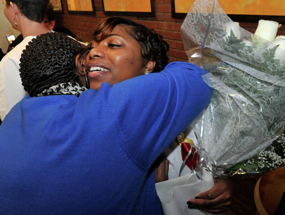 Nursing graduate Ashley Lyle, right, of Stamford, hugs her mother, Patricia Jones following the Pinning Ceremony for Norwalk Community College nursing students at the college in Norwalk, Conn., on Thursday, Dec. 19, 2013. Photo: Jason Rearick / Stamford Advocate