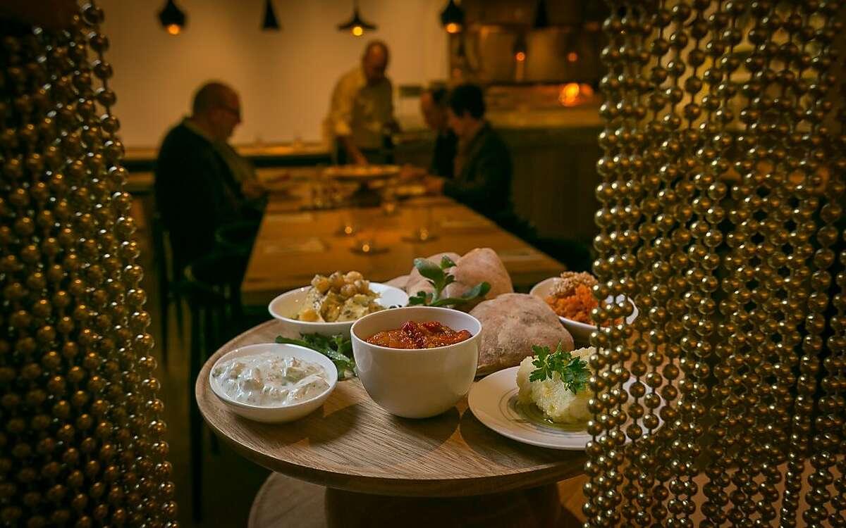 The Mezze platter with pickled Carrot Relish, Eastern European Lesco, Yogurt + Feta Salad, Hummus, and Skordalia of Potato + Cauliflower at Boulibar in San Francsico, Calif., is seen on December 13th, 2013.