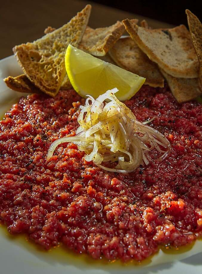 Steak tartare ($20) - minced, raw Wagyu steak combined with tart, marinated onions. Photo: John Storey, Special To The Chronicle