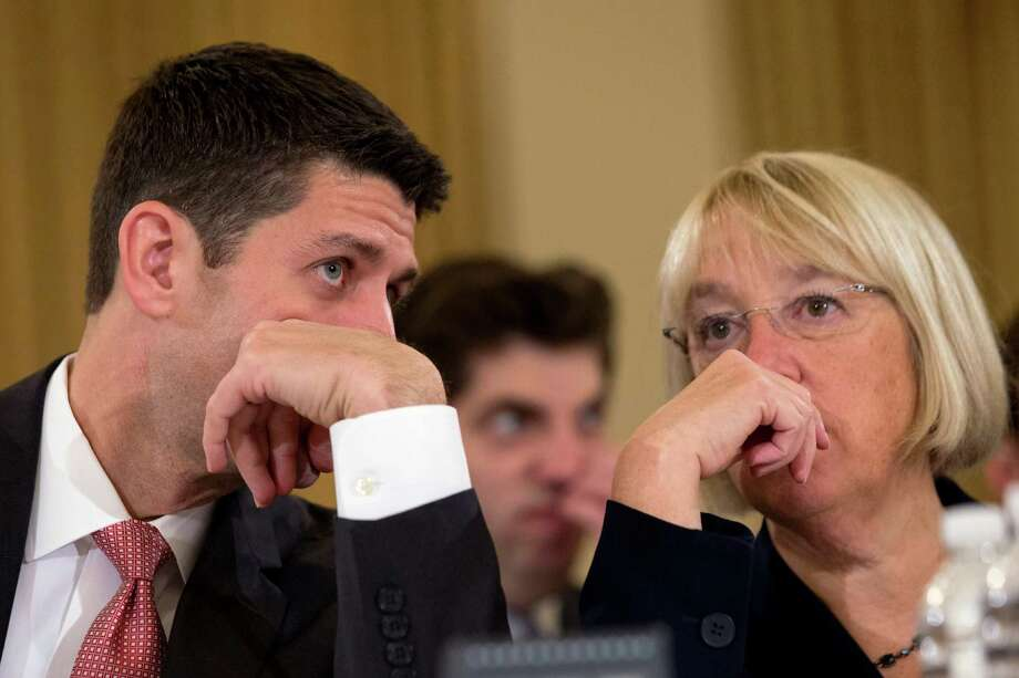 FILE - This Nov. 13, 2013 file photo shows House Budget Committee Chairman Rep. Paul Ryan, R-Wis., left, speaking with Senate Budget Committee Chair Sen. Patty Murray, D-Wash. on Capitol Hill in Washington at the start of a Congressional Budget Conference. Ryan likened his 2-year budget agreement with Democrats to taking a few steps in the right direction. But the bipartisan deal also carries potential value for Republicans and Ryan himself at a time when the party lacks a clear leader ahead of the 2014 midterm election. If the agreement eventually comes to represent the badly needed bridge between Republican factions, Ryan was its builder.  (AP Photo/Jacquelyn Martin, File) Photo: Jacquelyn Martin, STF / AP