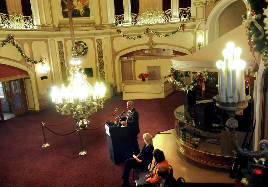 Mayor Jerry Jennings, center, talks about the energy-saving benefits of the new LED lights in the chandelier on Thursday, Dec. 19, 2013, at the Palace Theatre in Albany, N.Y. (Cindy Schultz / Times Union) Photo: Cindy Schultz / 10025108A