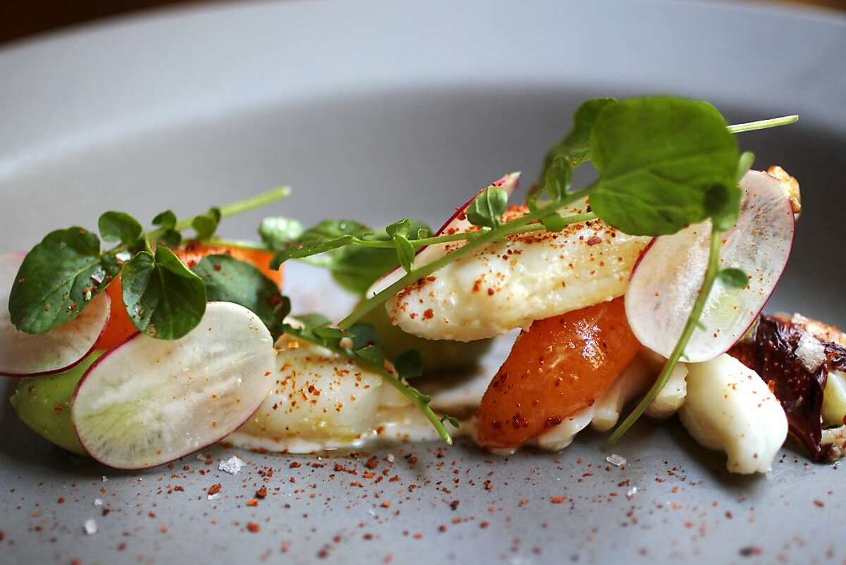 Aleppo pepper on a Dungeness crab with avocado, urfa chili, meyer lemon, and mandarins appetizer December 11, 2013 at Fifth Floor in Hotel Palomar in San Francisco, Calif.