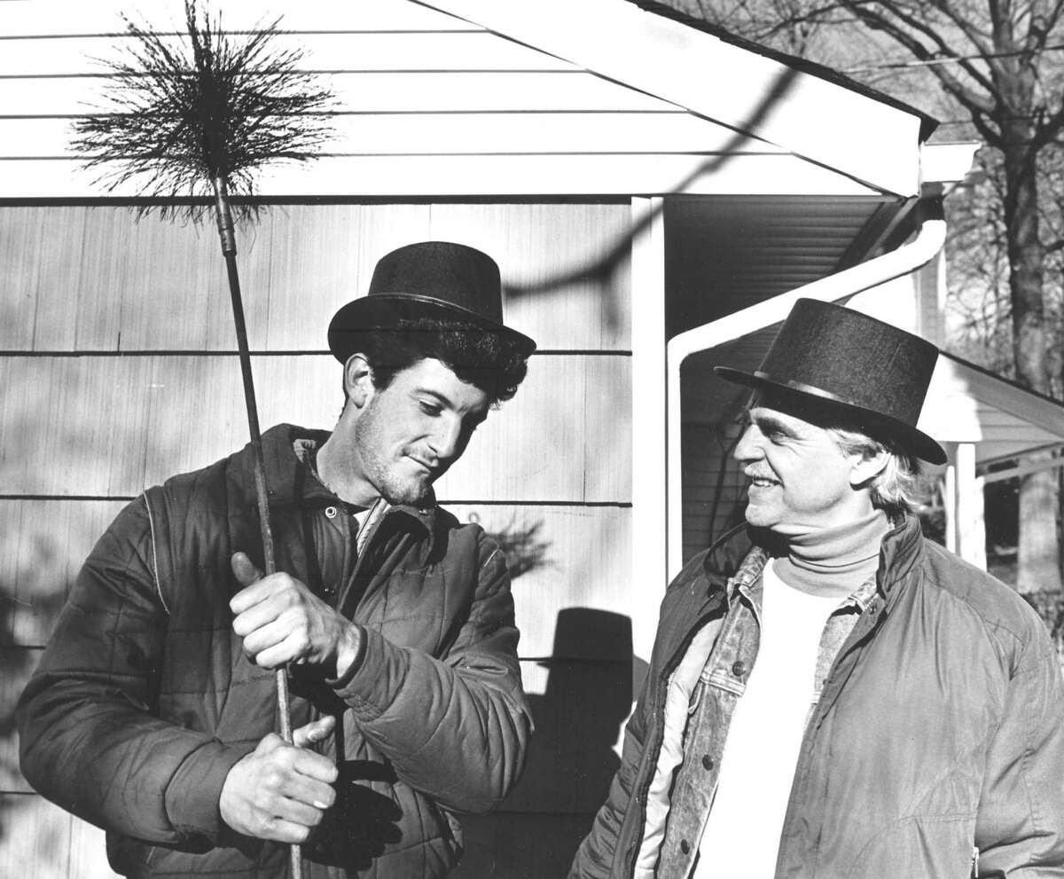 Donald Lyons, left, an assistant, and Richard Lemke, owner of Chim-Chiminey chimney service, prepare to work at a home on Clay Hill Road in Stamford on Dec. 22, 1988.
