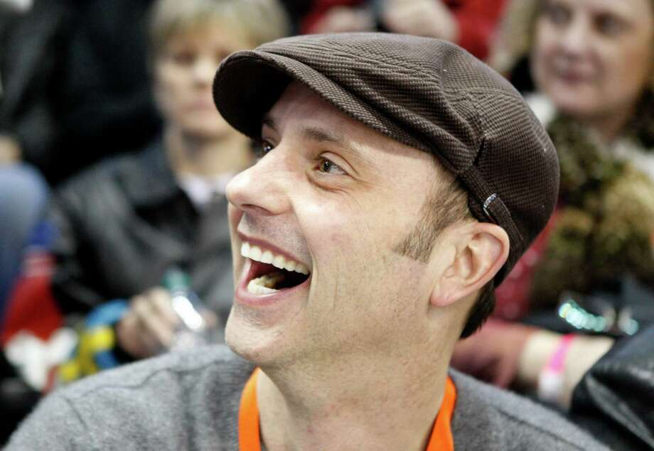 "FILE - In this Jan. 15, 2010 file photo, former Olympian Brian Boitano smiles in the stands during the men's singles competition at the U.S. figure skating championships in Spokane, Wash. Two days after being named to the U.S. delegation for Sochi, Boitano has announced he is gay. But the 1988 gold medalist says Thursday, Dec. 19, 2013,  in a statement that ""being gay is just one part of who I am. ... I hope we can remain focused on the Olympic spirit which celebrates achievement in sport by peoples of all nations."" (AP Photo/Rick Bowmer, File) ORG XMIT: NY154 Photo: Rick Bowmer / AP"