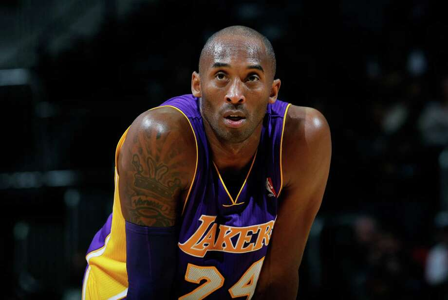ATLANTA, GA - DECEMBER 16:  Kobe Bryant #24 of the Los Angeles Lakers stands during a free throw against the Atlanta Hawks at Philips Arena on December 16, 2013 in Atlanta, Georgia.  NOTE TO USER: User expressly acknowledges and agrees that, by downloading and or using this photograph, User is consenting to the terms and conditions of the Getty Images License Agreement.  (Photo by Kevin C. Cox/Getty Images) Photo: Kevin C. Cox, Staff / 2013 Getty Images