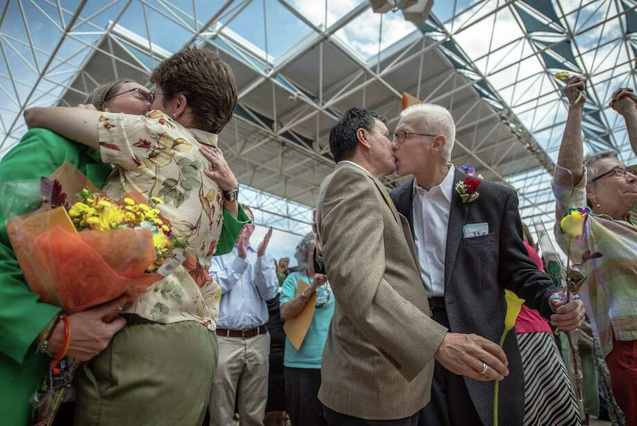 Same-sex couples pack the Bernalillo County clerk's office in Albuquerque with anticipation of obtaining marriage licenses. Photo: Albuquerque Journal / File Photo / ALBUQUERQUE JOURNAL