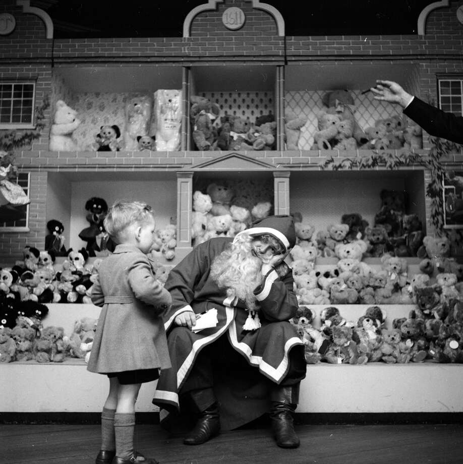 A resolutely tired Denzil Batchelor, in costume as Father Christmas, wearily answers another child's question at Harrods department store in London on Dec. 19, 1953. Photo: John Chillingworth, Getty Images / Picture Post